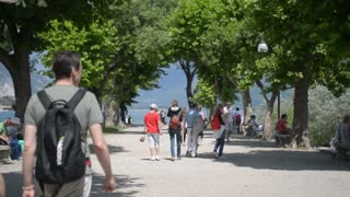 Embankment of the european town, tourists walking streets - Italy Lago Maggiore