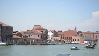 Embankment Pier of island Murano in Venice - The ship is moored to the dock