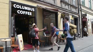 Facade of cafe Columbus coffee - people tourists come inside to drink a coffee