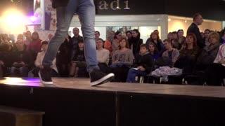 Fashion Bright Show Slender Young Boy Model Legs Walking On A Catwalk