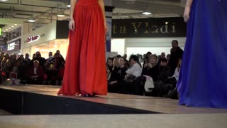 Fashion Bright Show Slender Young Girl Model in wedding balroom dress Legs Walking On A Catwalk
