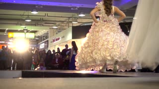 Fashion Bright Show Slender Young Girl Model in wedding dress Legs Walking On A Catwalk
