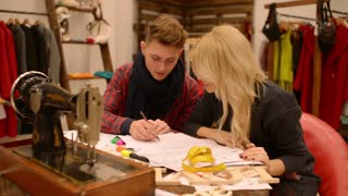 fashion designer and seamstress cutter discuss new collection