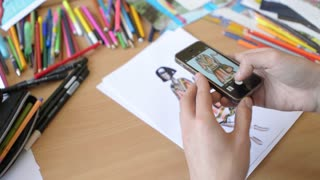 Fashion Designer Makes Photo By Sell Phone Of A New Collection Of Sketches Stock Video Footage Storyblocks
