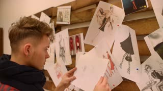 Fashion designer sketches a new collection attaches to the board