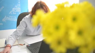 Female Manager Working At Office With laptop computer