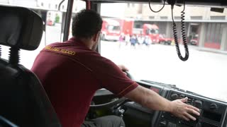Fire engine rides on emergency call about a fire in the fire station in Milan
