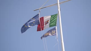 flags of Italy are waving in the sky