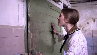 Frightened woman locked herself in the basement trying to open the lock door