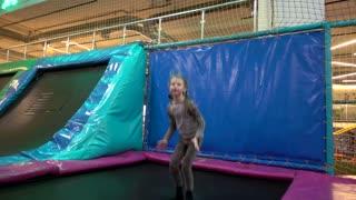 Girl kid jumping on the Trampoline having fun