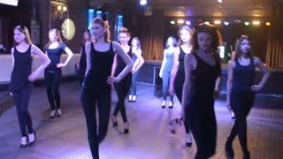 Girls dancing in synchronized dance Contemporary nightclub