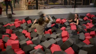 girls play in the pit with foam smiling having fun