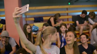 Girls Students make Selfie Photo Mobile Phone on the School Hall Stands