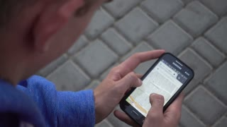 Google Maps On Mobile Sell Phone - Man looking searching New York