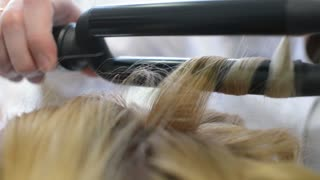 Hairstyle Artist makes Hair Curling Iron Procedure