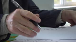 Hand Of A Business Man handle Text Documents With Pen 4K