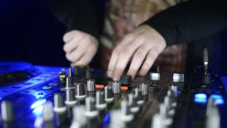 Hands Of Dj Tweak Controls On Record Deck In Night Club. Turntable, Mixer, Plate