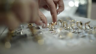Jewels Market - the seller shows gold jewelry earrings, rings, bracelets, chain