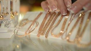 Jewels Market - the seller shows gold jewelry earrings, rings, bracelets, chain