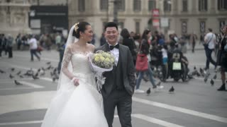 Just married Korean couple on Piazza Duomo in Milan, posing for a photo shoot