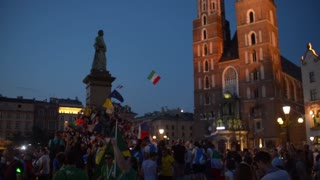 Krakow Old Town Market Square At Night - croud of people World Youth Days