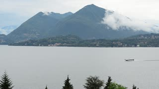 Lake Lago Maggiore Italy. Ship boat ferry glides through the water.