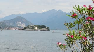 Lake Lago Maggiore Italy. Ship boat ferry glides through the water