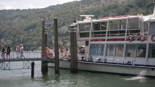 Lake Lago Maggiore. Passengers leave the ship on the island