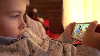 Little Boy Watch Cartoon Via Smart Phone Display