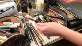 Make-up artist of the brush picks for applying makeup
