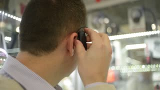 Man attaches to the ear bluetooth device