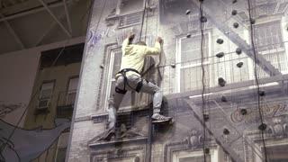 Man On An Indoor Climbing Wall