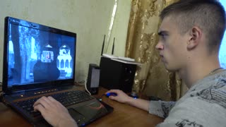 Man Playing Shooter Computer Game with emotions on face