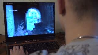 Man Playing Shooter Computer Game