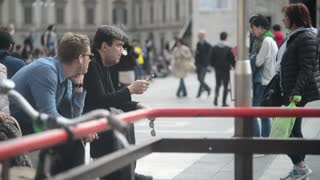man smokes electronic cigarette near the Duomo in Milan
