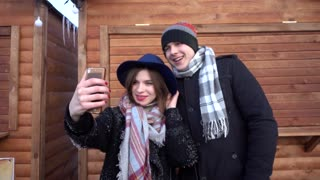 Man Woman taking selfie photo with Mobile Cell Phone iphone - winter day funy