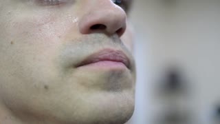 man's face covered in sweat