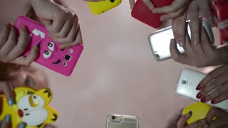 Many children with mobile phones in the hands