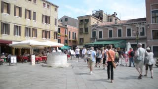 Market streets and shops of Venice. People walk along the cafes and souvenir shops