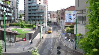 Milan business center city - old tram rides on rails