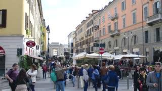 Milan business center city - pedestrians walk and relax - Corso Como spring