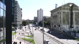 Milan business center of the city - skyscrapers and traffic, pedestrians walk