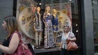 Milan city center. Pedestrians view windows dresses, Monte Napoleone shopping.