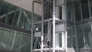 Milan Expo 2015 Pavilion of Italy. Elevator of glass with passengers gose down