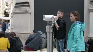 Milan Gallery Vittorio Emanuele, boy looking to binoculars under the dome