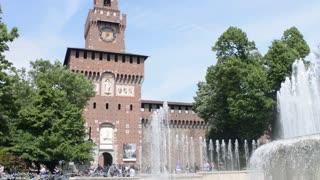 Milan, Italy - Fountain la turta di spus - pedestrian walking by to Castello