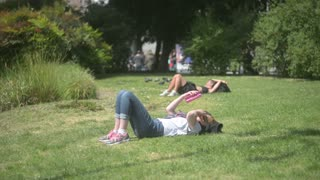 Milan, Italy - park Sempione - people have rest, relaxing on the sun