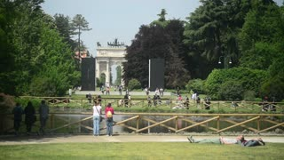 Milan, Italy - park Sempione - people have rest, walking, relaxing on the sun