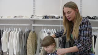 Mom and daughter while shopping in a clothing store