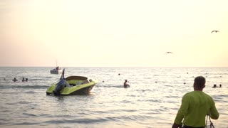 Motor boat near the sea swaying on the waves